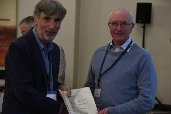 Dave Mountfort receives his Farrer Medal certificate