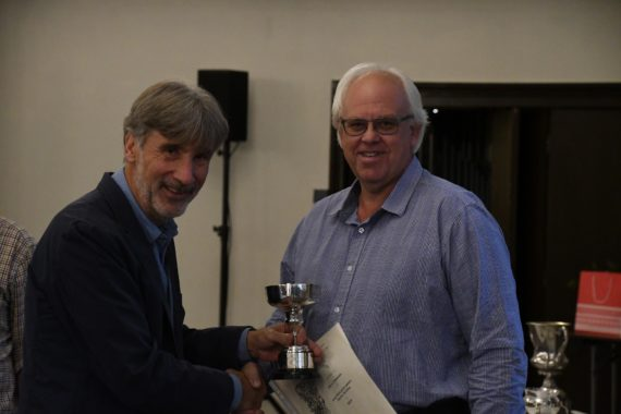 Steve Clements receives his Bronze and Silver Medals plus the Donald Lowndes Memorial Bowl and Clifford Crook Cup